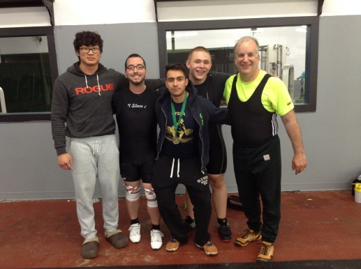 Coach James at the 2015 Elmira Open with a few of his Barbell Club athletes. From left to right: Tim, James, Anthony, Patrick, Martin